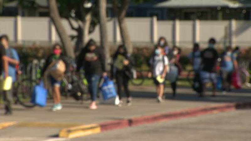 Hawaii's public school students returned to class Tuesday, wearing masks and excited about the...