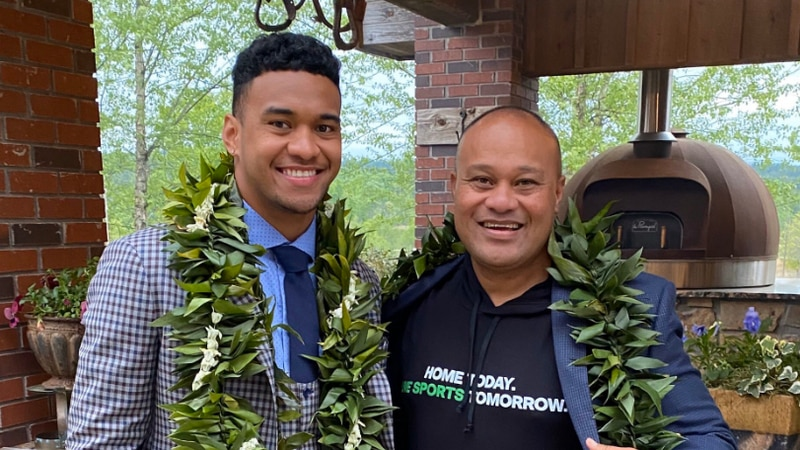 Tua Tagovailoa with his father, Galu, after the 2020 NFL Draft in April.