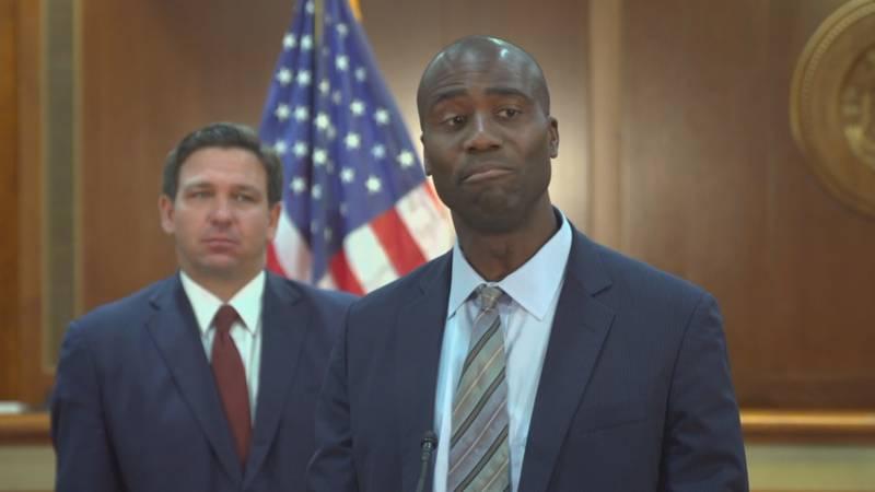 Gov. Ron DeSantis is shown with new Florida Surgeon General Dr. Joseph Ladapo. Democratic state...