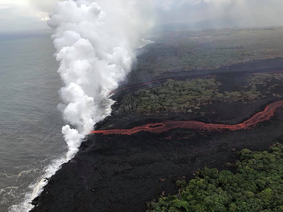 An aerial image show the plume caused as lava pours into the ocean. (Image: Dave Okita)
