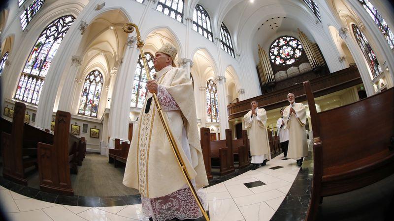 In this Sunday, April 12, 2020 file photo, Denver Archbishop Samuel J. Aquila enters the...