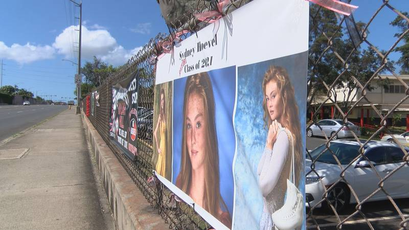 Graduation posters are displayed infront of Radford High School.