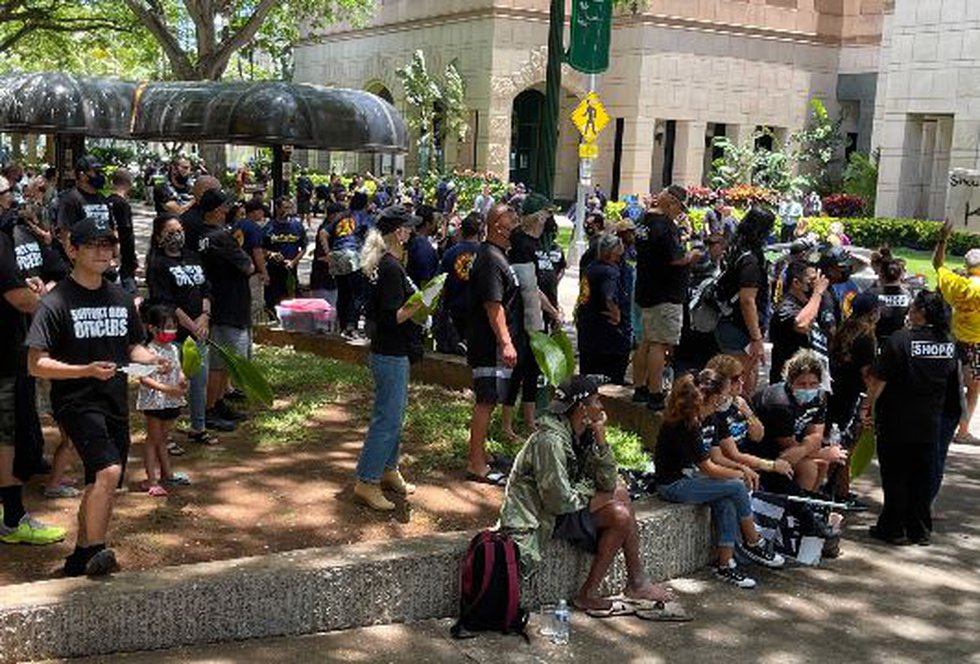 A group of supporters for three officers charged in a teen's killing gathered outside the...