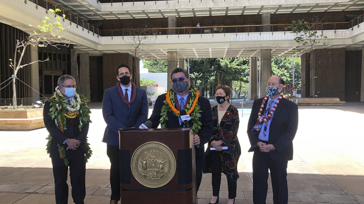Hawaii Senate President Ron Kouchi speaks at a podium at the state Capitol in Honolulu on...