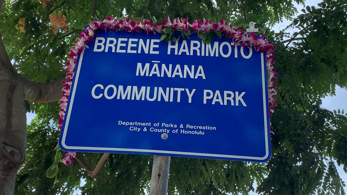 One of the new signs were draped in lei after the unveiling Monday.