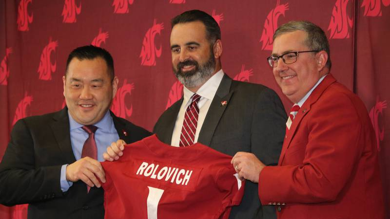 Former Hawaii head coach Nick Rolovich (center) is introduced as Washington State's new head...