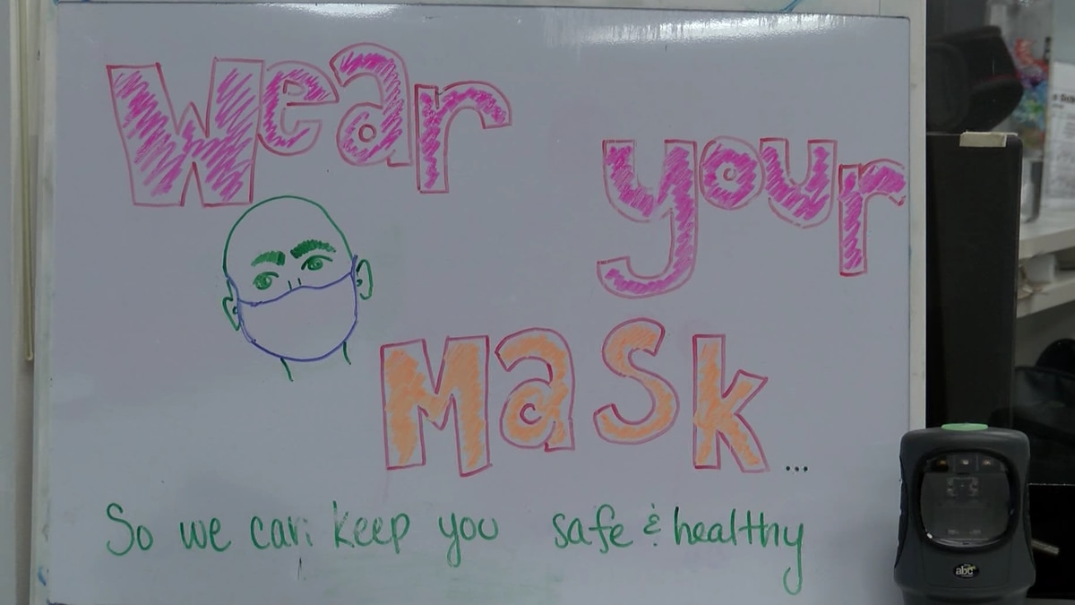 Powerhouse Gym has the sign posted on their front desk reminding members to wear their masks.