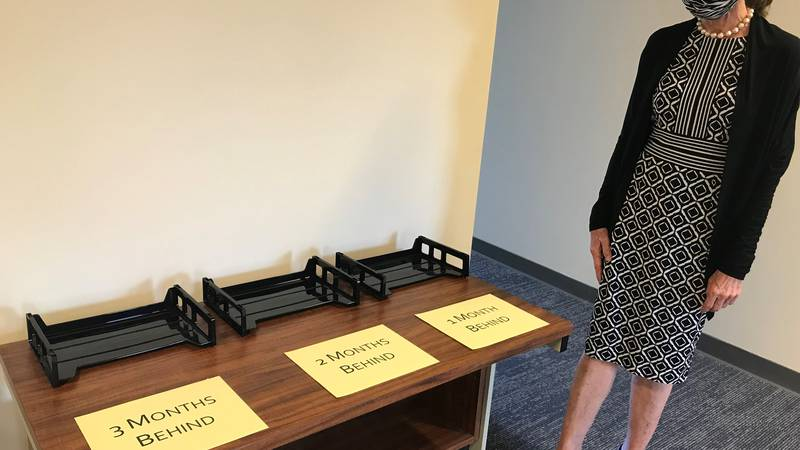 Tracey Wiltgen, executive director of The Mediation Center of the Pacific, shows folders that...