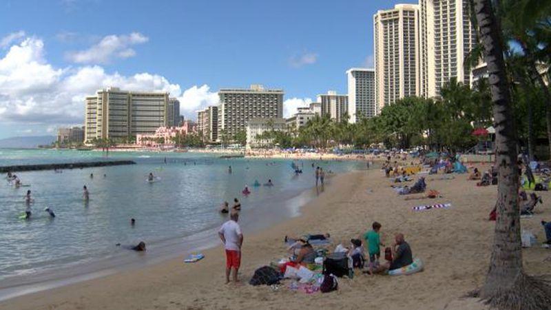 Visitors lounge on Waikiki Beach. (File photo)