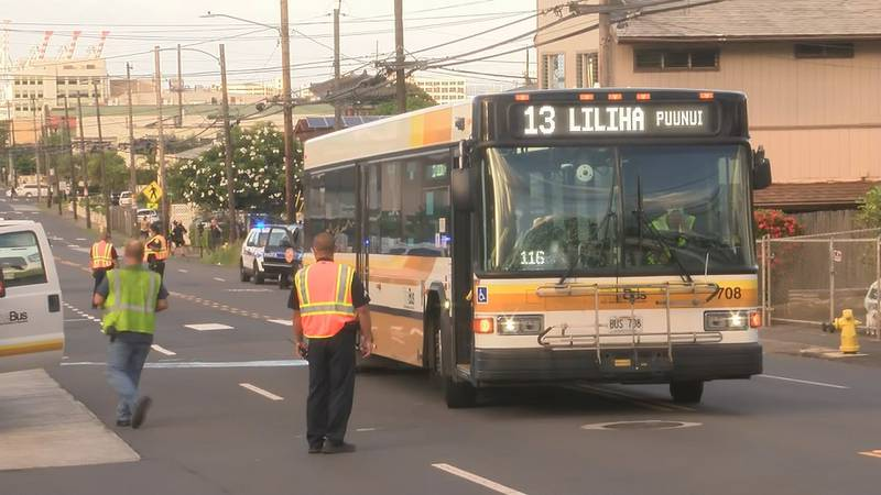 A woman was critically injured after she was pinned under a bus on Liliha Street.