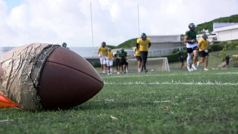 Leilehua High School Varsity Football Team warming up for practice in August.