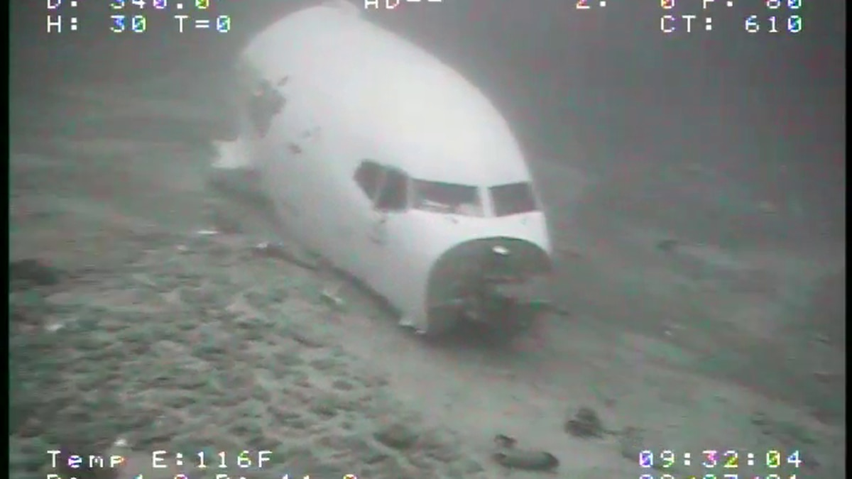 The wreckage of a cargo plane that crashed off Oahu is resting at a depth of 360 to 420 feet.