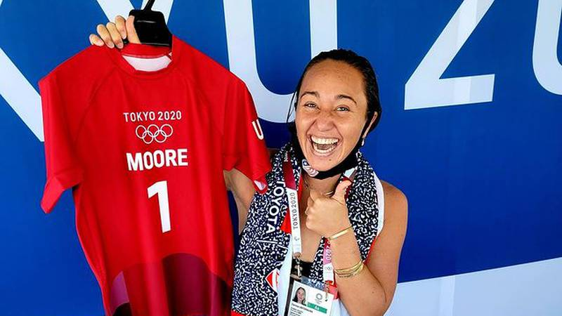 Carissa Moore poses with her competition jersey.