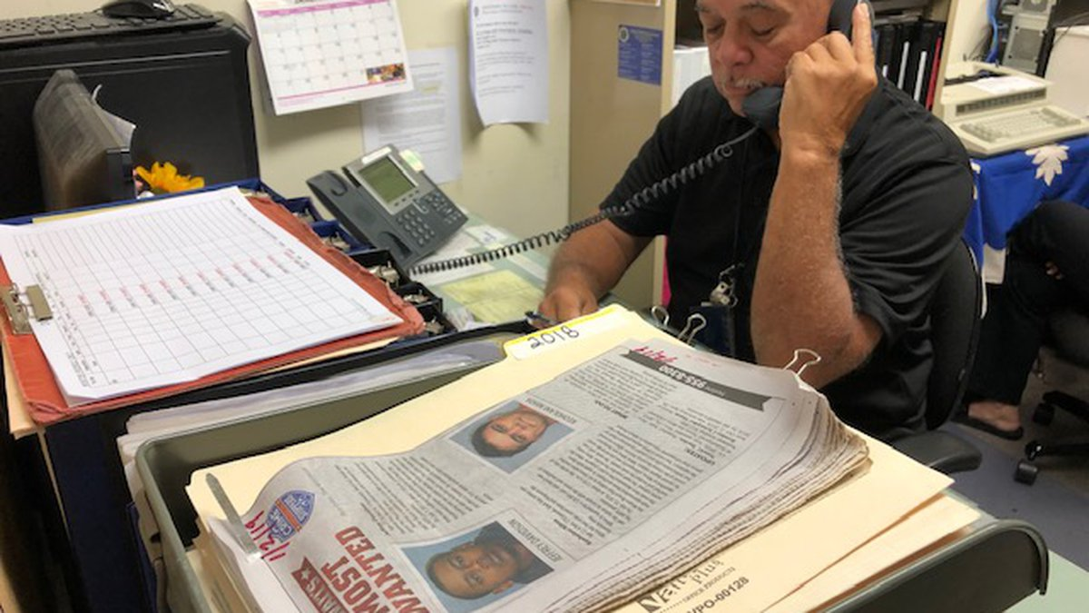 Veteran CrimeStoppers volunteer Val Huihui takes a call from someone submitting an anonymous...