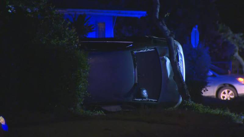Police are investigating how a car flipped onto its side and ended up in the yard of a Kaneohe...