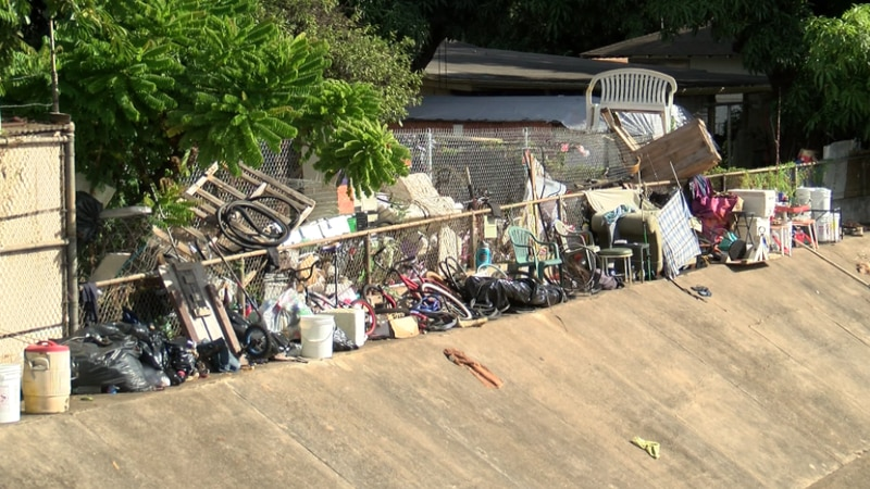 A homeless man's possessions are growing on a vacant lot near Waimalu Stream.