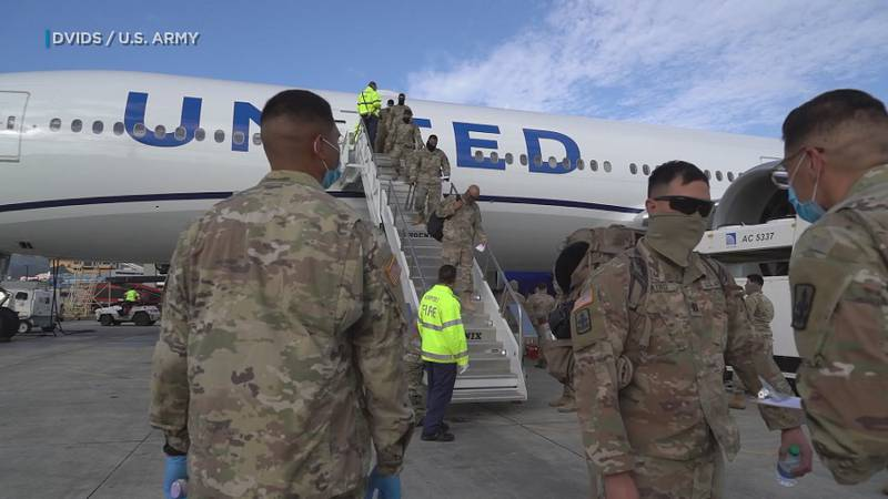 Hundreds of Hawaii National Guard members were greeted with temperature checks and salutes in a...