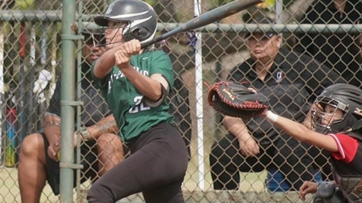 A softball player from Mid-Pacific swings the bat in a game against Iolani.