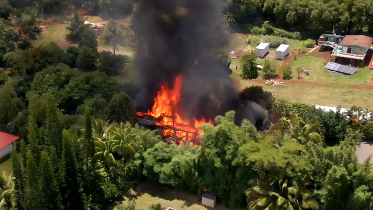 The fire tore through two homes in Moloaa.