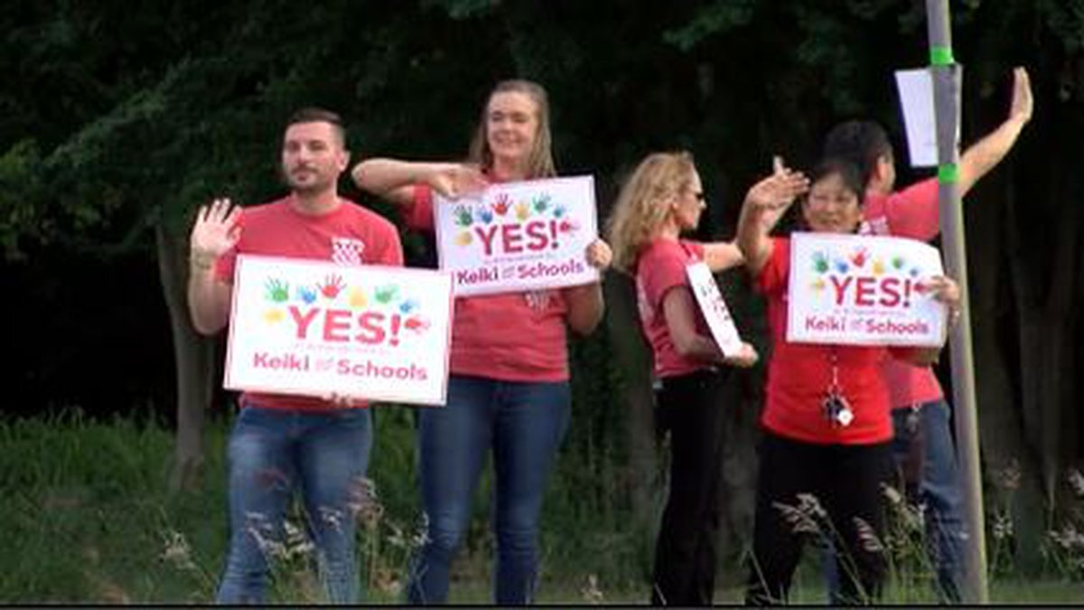 Parents joined teachers at Hawaii schools to rally in support of the constitutional amendment.