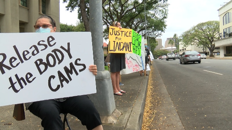 Two dozens of people protest against police brutality outside of HPD Tuesday.