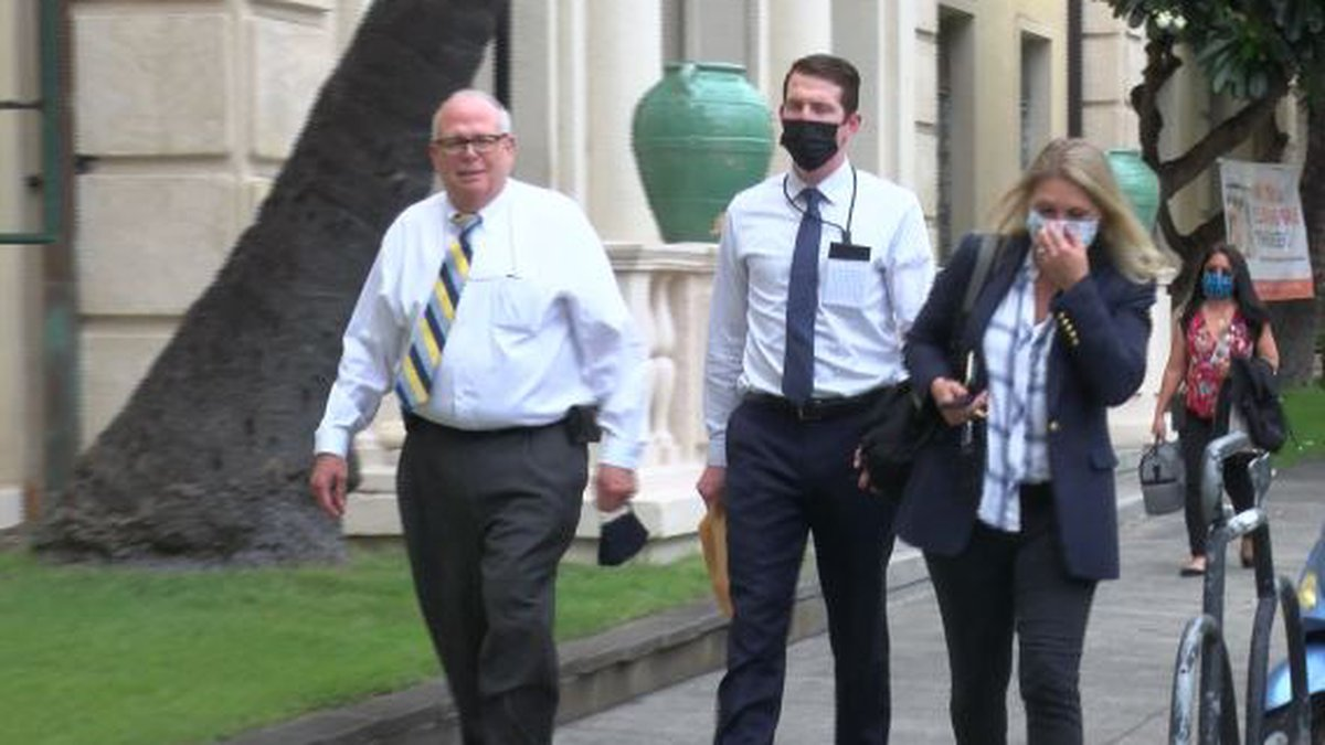 Assistant U.S. Attorneys and an FBI agent leave the city prosecutor's office after a meeting in...