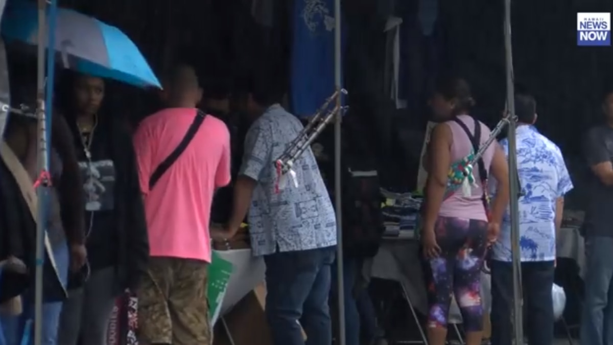 Shoppers made their way through the rain to shop at the Aloha Stadium Swap Meet, Saturday.
