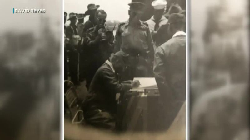 Tucked away in a scrapbook for years, secretly-captured images show surrender ceremony