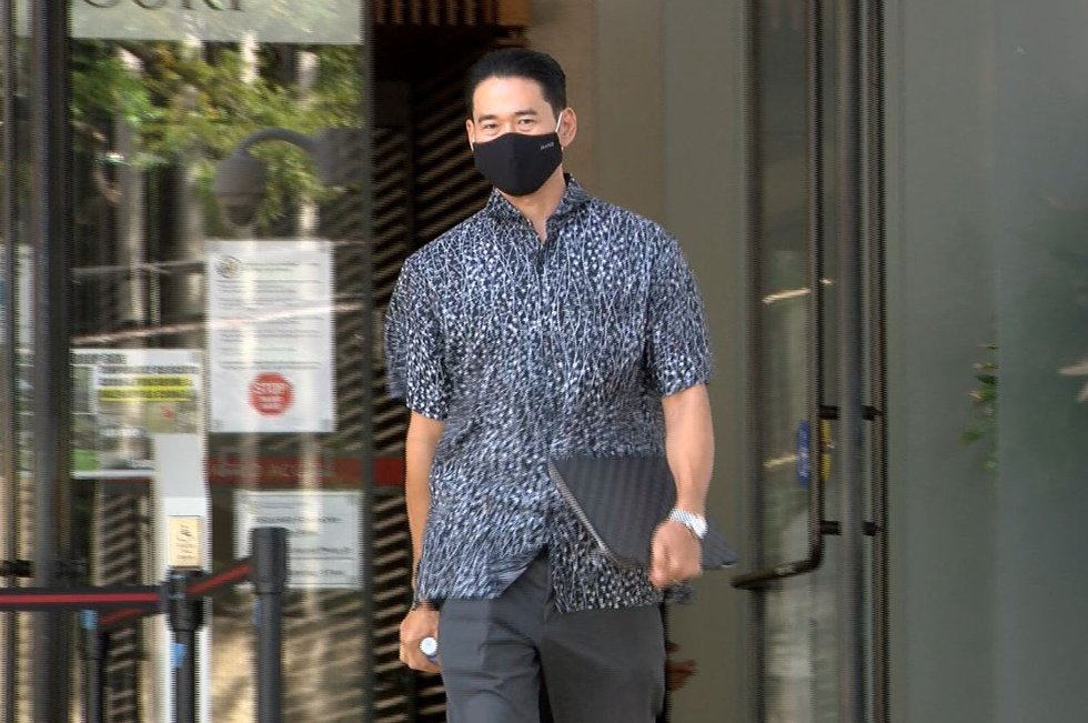 Ryan Shindo of Mitsunaga & Associates, Inc., leaves the federal courthouse after appearing...