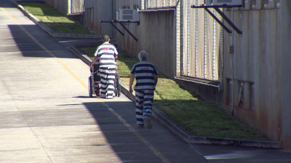 File photo of inmates walking down a corridor at the Halawa Correctional Facility. (Image:...