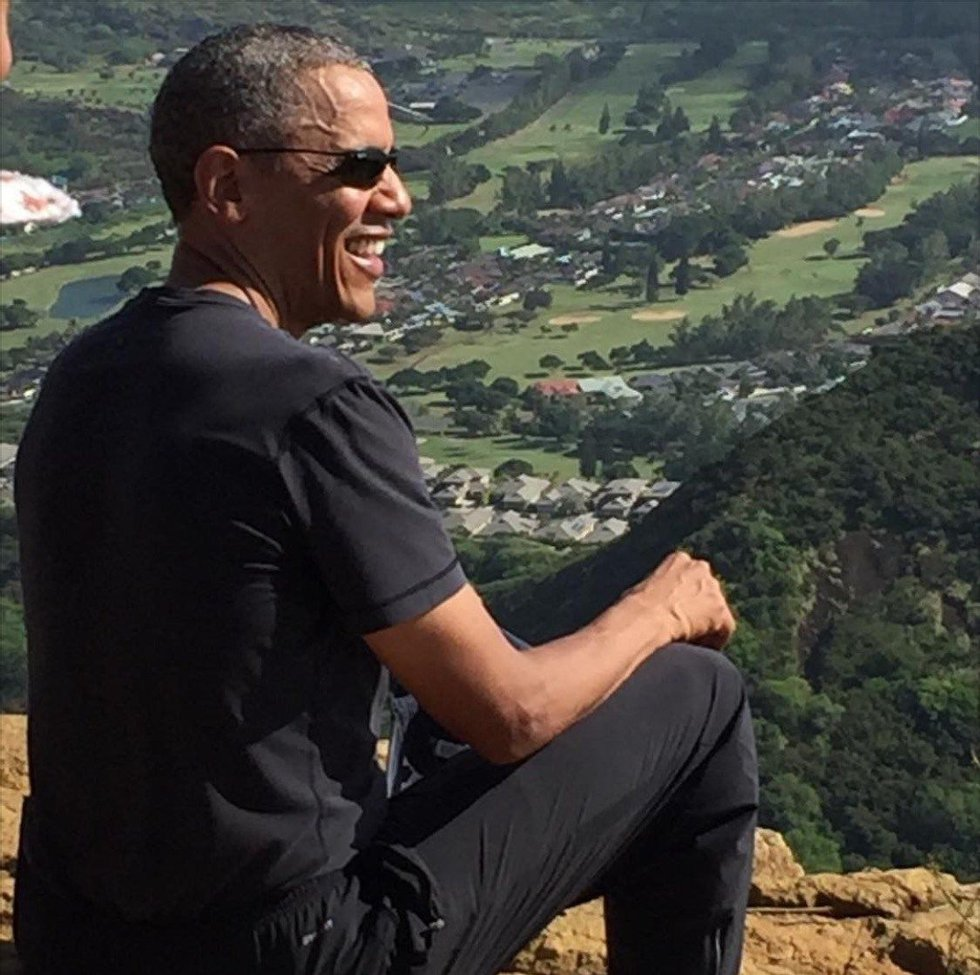 The president takes a look at the view after hiking up Koko Crater Railway Trail. Image...