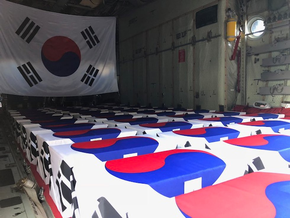 Boxes holding skeletal remains of South Korean soldiers killed during the Korean War line the...