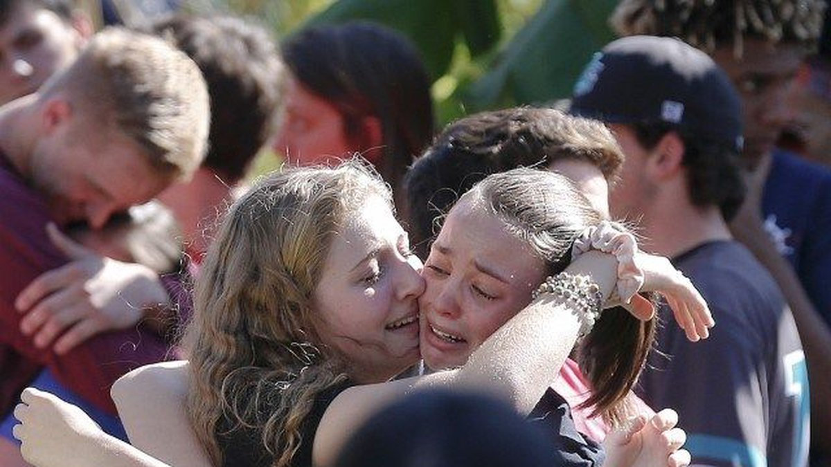 Students grieve at Pine Trails Park for the victims of the Wednesday shooting at Marjory...