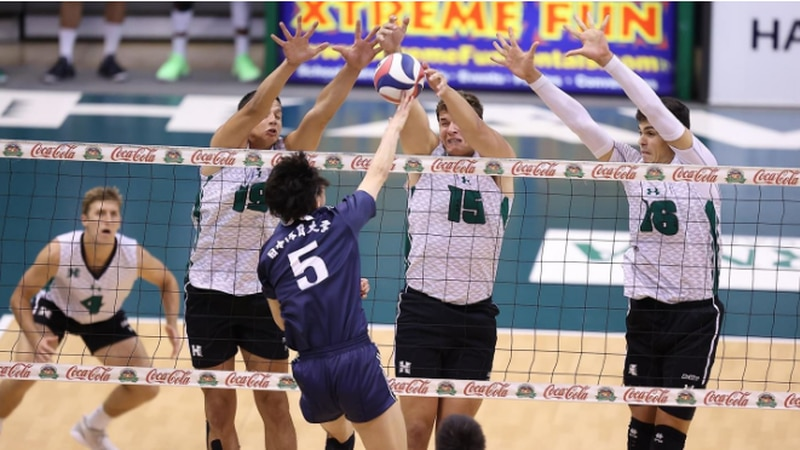 'Bows combine at the net for block in four set win over Japan's Nittaidai University.