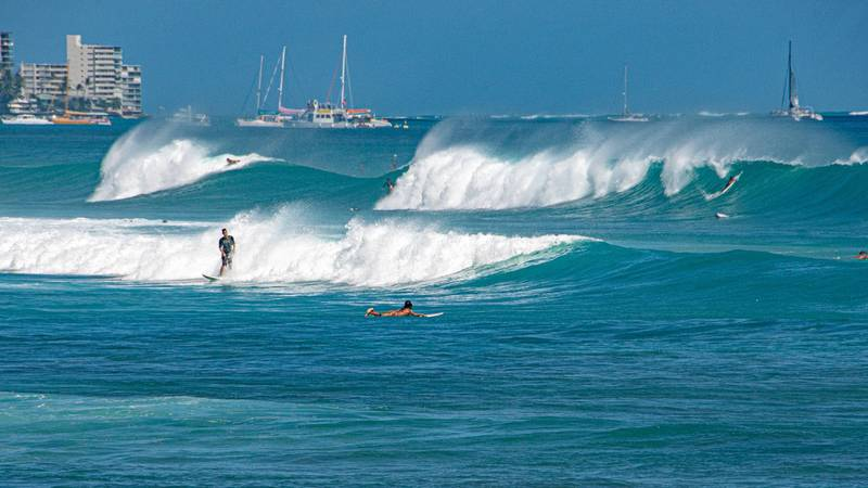 A swell attracted surfers along Oahu's south shore in June.