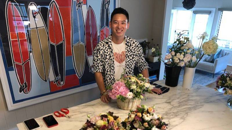 Florist Kaiwen Wang Nobriga shows off some of the floral arrangements that will be given to...