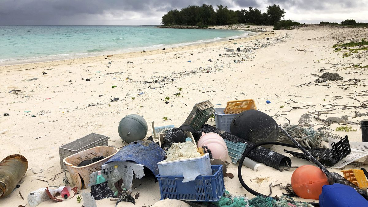 In this Oct. 22, 2019, photo, plastic and other marine debris sits on the beach on Midway Atoll...