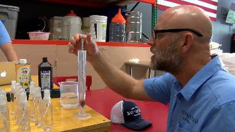 Ko'olau distillery CEO Eric Dill devises hand sanitizer in his Kailua warehouse.