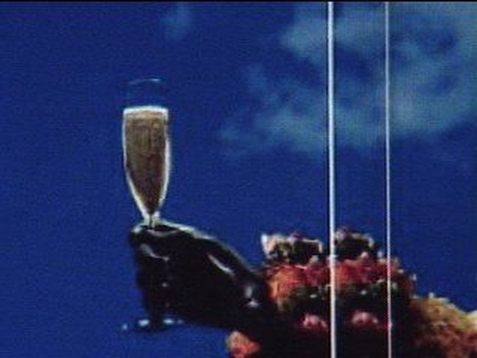 The ad depicts King Kamehameha holding a champagne glass