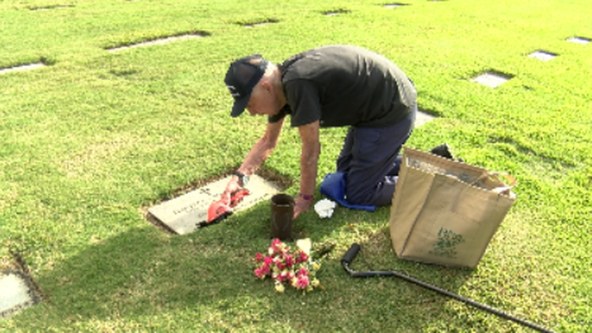 Ted Richardson trims the grass around his late wife's head stone at Punchbowl cemetery. He has ...