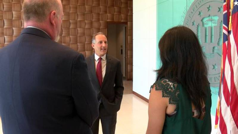Steven B. Merrill (center) is the new special agent in charge of Hawaii's branch of the Federal...