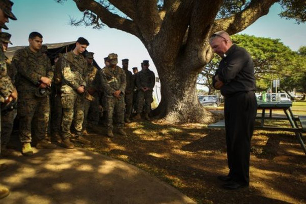 Search crews had a moment of silence Monday morning for the 12 Marines still missing after two...