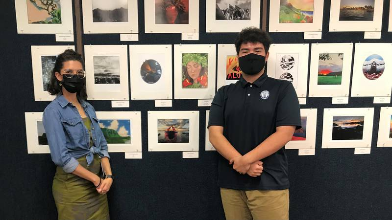 Kumu Ualani Davis and student Kieren McKee show student created artwork being used for Song...