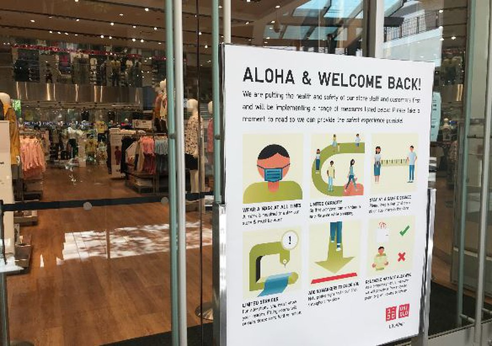 Signage is posted all over Ala Moana Center reminding customers to wear mask and practice good...