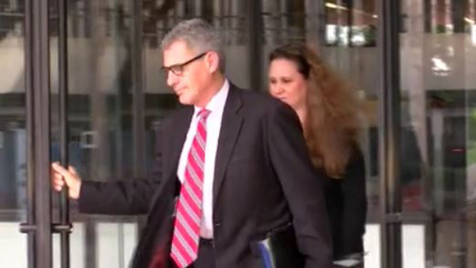 Attorney Myles Breiner leaves the federal courthouse with Katherine Kealoha in 2016.