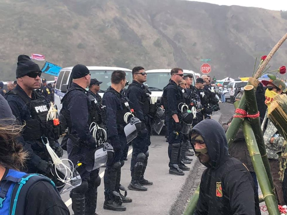 Police lined the roadway to the Mauna Kea summit on Wednesday afternoon. (Image: Hawaii News Now)