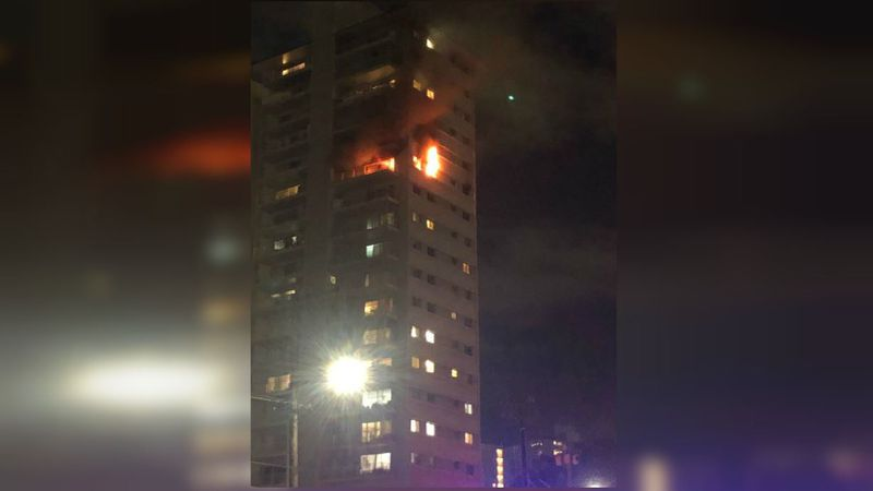 Flames were seen coming out of a unit in the highrise
