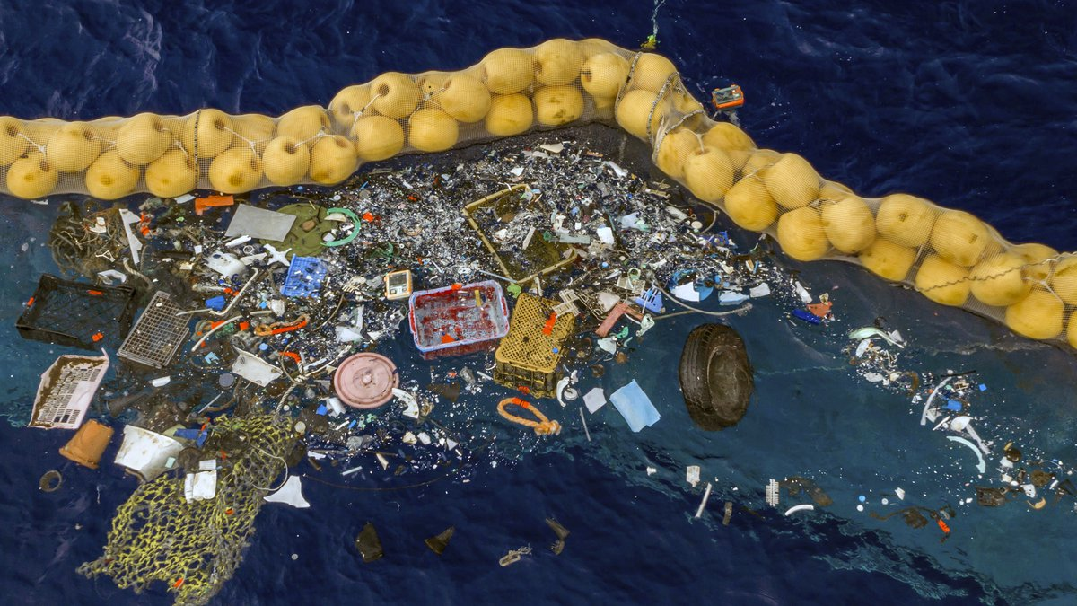 In this undated handout photo provided by The Ocean Clean Up, plastic is retained in front of...