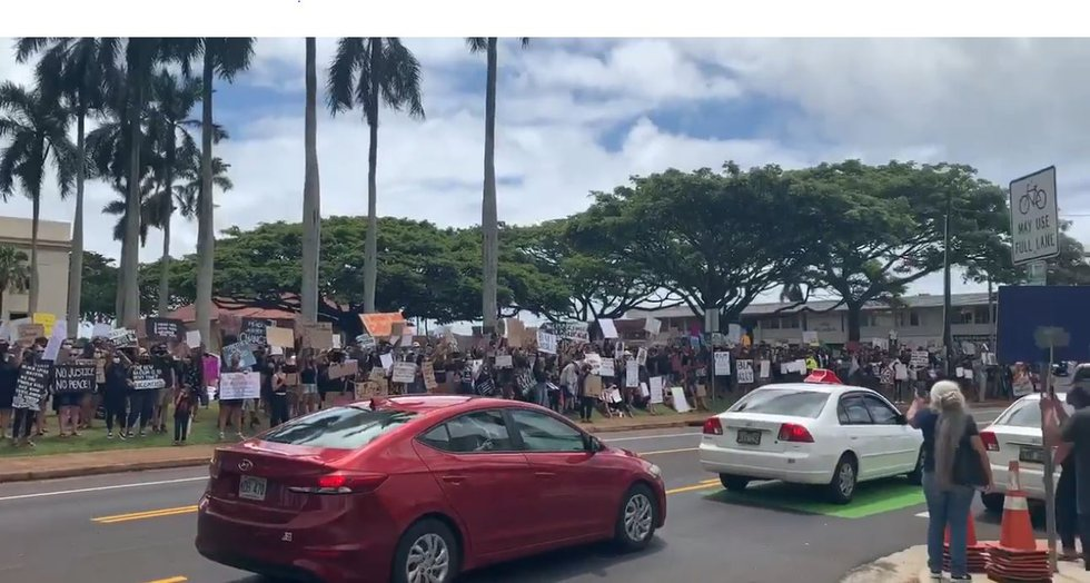 On Kauai, a crowd gathered on the lawn of the County Building.