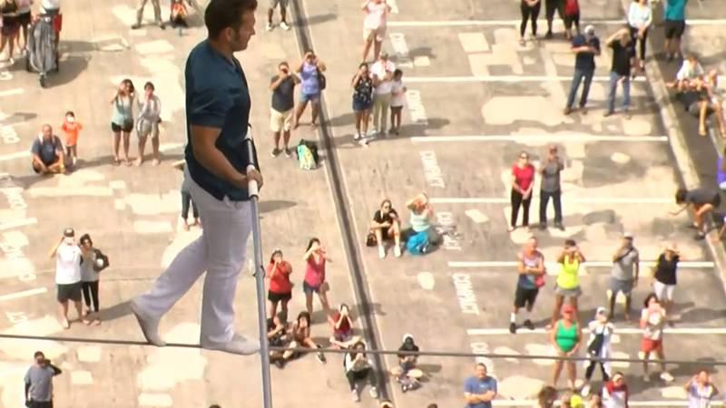 Daredevil Blake Wallenda walks on a highwire between two Ala Moana towers.